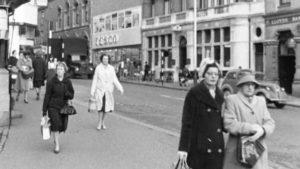 A 1962 photo showing women walking down the street