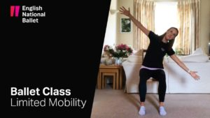 English National Ballet limited mobility class. Photo showing woman stretching on a chair.